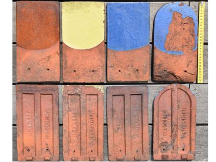 Une tuile vernissée et trois tuiles émaillées, dites carrées et écaille estampillées Bourgogne Montchanin